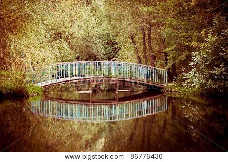 Old Bridge In The Park With Lake
