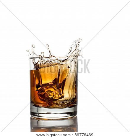 Isolated shot of whiskey with splash on white
