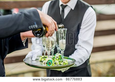 Waiter Holding Tray With Glasses