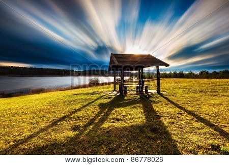Landscape With Wooden Hut. Long Exposure Photo.