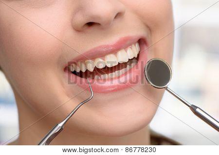 Close up of beautiful woman visiting dentist