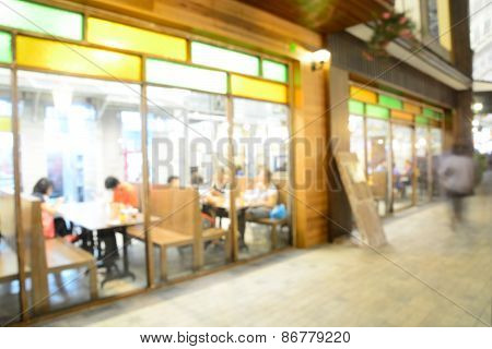 Blur Or Defocus Image Of People Dinner In Restaurant Or Food Center With Bokeh
