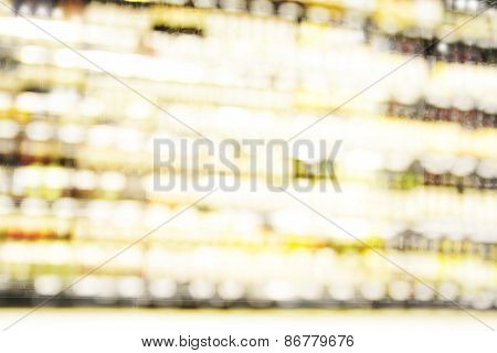 Blur or Defocus image of Wine on the Shelf of Liquor Store