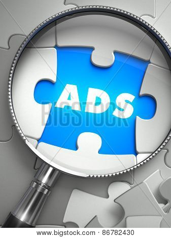Ads - Missing Puzzle Piece through Magnifier.
