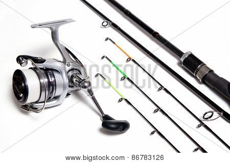 Fishing Feeder And Reel On White Background.