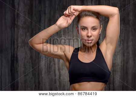 Close up of mixed race sporty woman raising arms up