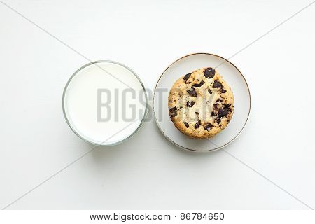Biscuit Cookies With Chocolate Chips And A Glass Of Milk