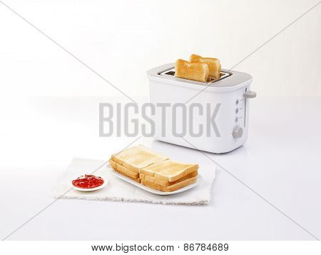 Bread Toaster And Toasted Bread