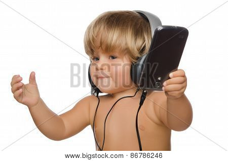 Smiling Baby With Headphones And Smartphone