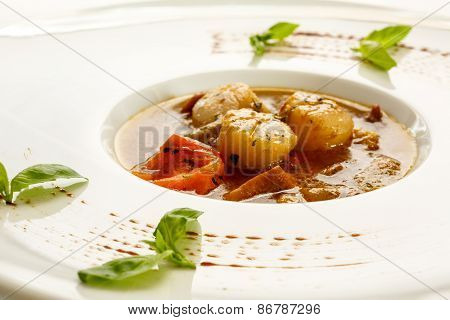 Soup with scallops and tomato