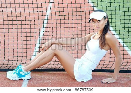 Young, Beautiful Girl On The Tennis Court