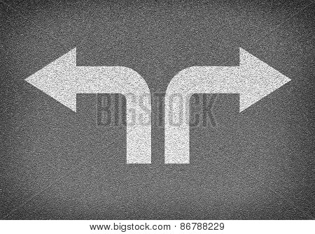 Asphalt road texture with two arrows