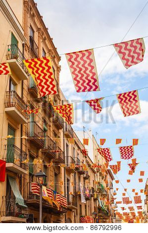 Flags Of Tarragona City And Catalonia Hanging Over Street