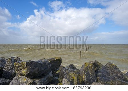 Barge sailing in a stormy lake in spring