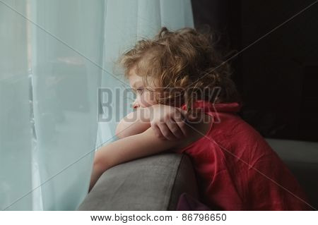 Girl Waiting For Someone And Looking Out The Window