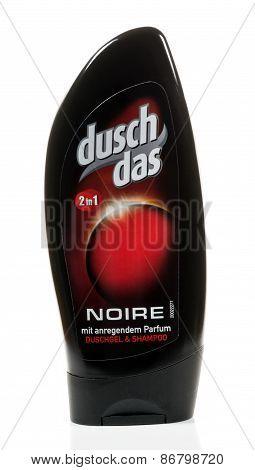 A bottle of Dusch Das shower gel