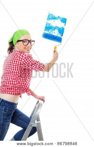 Happy Woman Painting A Wall An Blue Color, Isolated On White. Worker Female Holding Paint Roller And