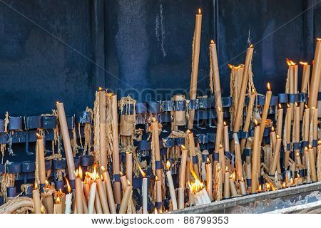 Sanctuary of Fatima, Portugal. Votive candles burning in the pyre as fulfillment of vows made to Our Lady. Fatima is one of the most important pilgrimage locations for Catholics