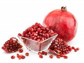 picture of whole-grain  - whole pomegranate with pieces and grains isolated on white background - JPG
