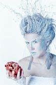 stock photo of snow queen  - Mysterious and unusual girl with face art in the form of the Snow Queen - JPG