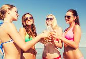 stock photo of sunbather  - summer vacation - JPG