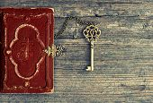 pic of vintage antique book  - Antique bible book and golden key on wooden background - JPG