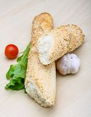 stock photo of crust  - Fresh crust Baguette with sesame seeds and salad - JPG
