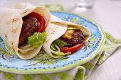 image of beef-burger  - Fresh tortilla wrap with grilled beef burger and vegetables - JPG