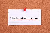 stock photo of thinking outside box  - Think outside the box text paper is pinned on cork - JPG