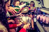 stock photo of hen party  - Happy girls having fun in limo drinking champagne hen - JPG