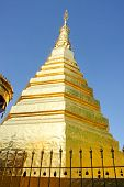 foto of cho-cho  - Gold pagoda wat phra that cho haephrae province Thailand.