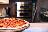 picture of oven  - pizza oven and tasty hot pizza on the table - JPG