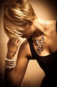 image of jewelry  - short hair blond elegant young woman portrait wearing jewelry - JPG