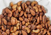 stock photo of mixed nut  - Roasted nuts mix piled on paper napkin - JPG