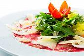 foto of mushroom  - Isolated beef carpaccio served with salad rocket - JPG