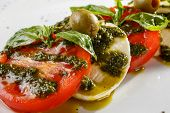 picture of basil leaves  - Traditional Italian caprese served on a plate with pesto - JPG