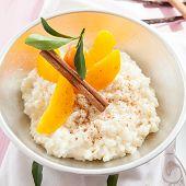 foto of kumquat  - Bowl of rice pudding with peaches and kumquat  - JPG
