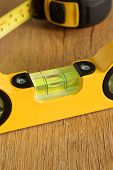 stock photo of carpentry  - Carpenters spirit level selective focus on the bubble a woodworking or carpentry concept - JPG