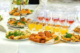 foto of banquet  - Pies eclairs and drinks on a banquet table  - JPG
