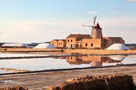 stock photo of marsala  - Windmill at sunset in the saltern near Marsala - JPG