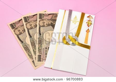 Japanese Gift Envelope And Ten Thousand Yen Bill.