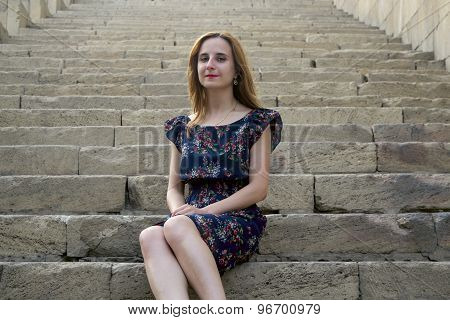 Young  Girl On The Stairs