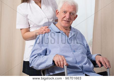 Elder Man In A Wheelchair