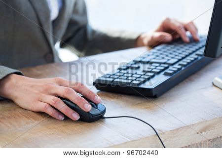 Businessman using his computer at the office