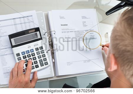 Close-up Of Businessman Inspecting Bills