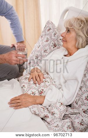 Ill Older Woman In Bed