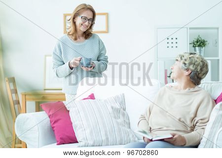 Aged Pensioner And Smiling Caregiver