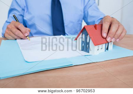 Businessman reading a contrat before signing it in the office