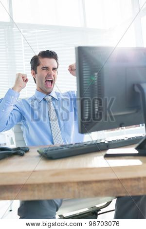 Close up of cheerful businessman cheering in the office