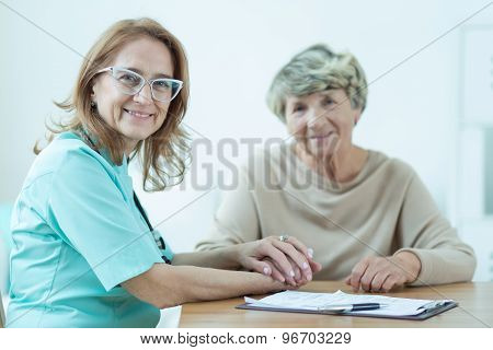 Kind Female Medic With Patient
